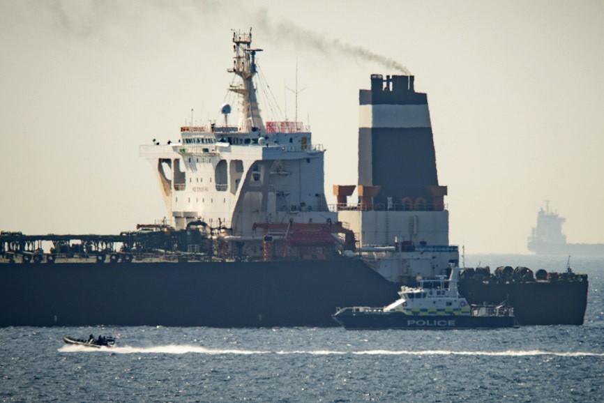 Royal Marine patrol vessel is seen beside  the Gra...