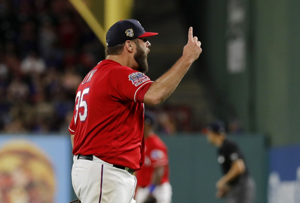 Texas Rangers' Lance Lynn celebrates after getting Los Angeles Angels' Shohei Ohtani to fly out to end the top of the seventh inning of a baseball gam