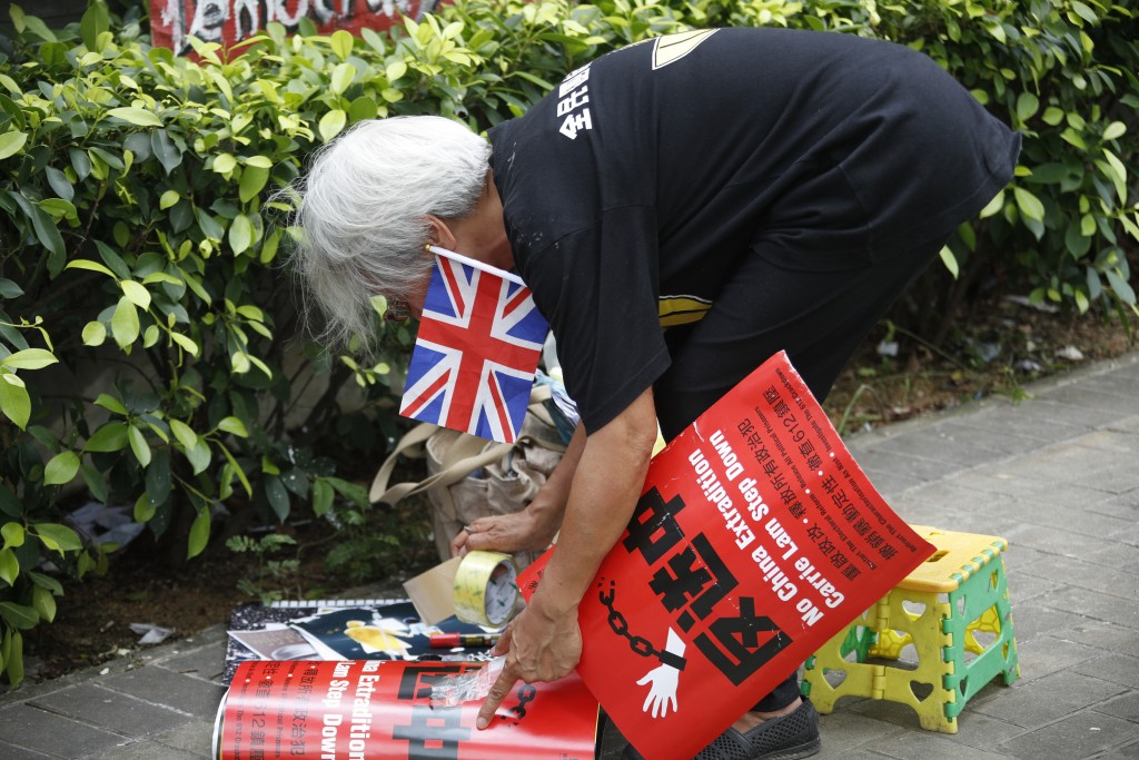 In this Thursday July 4, 2019, photo, Alexandra Wong, 63, a protester who's often seen raising the Union Jack at demonstrations and carried one into t...
