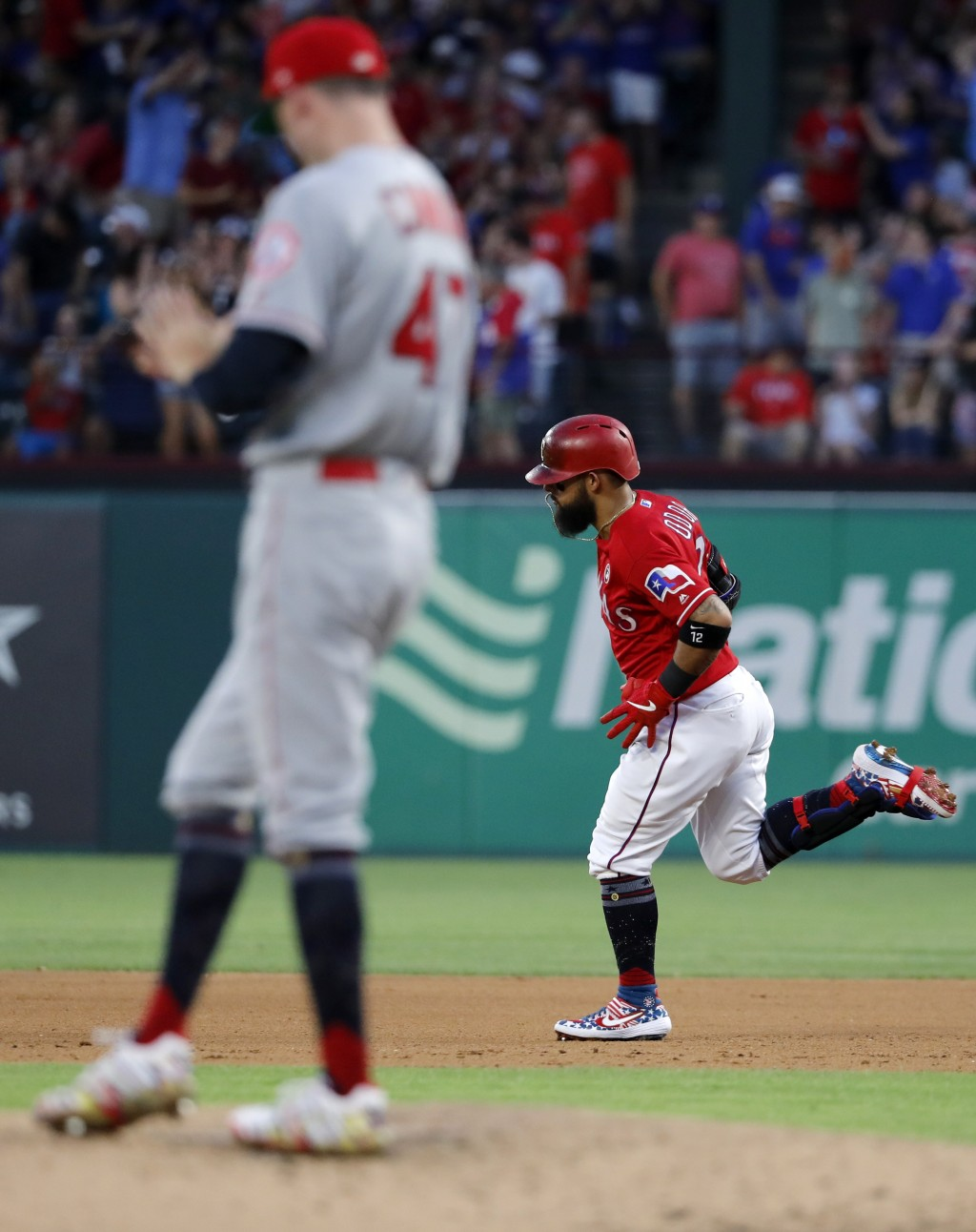 Los Angeles Angels starting pitcher Griffin Canning (47) stands on the mound as Texas Rangers' Rougned Odor (12) rounds the bases after hitting a two-...