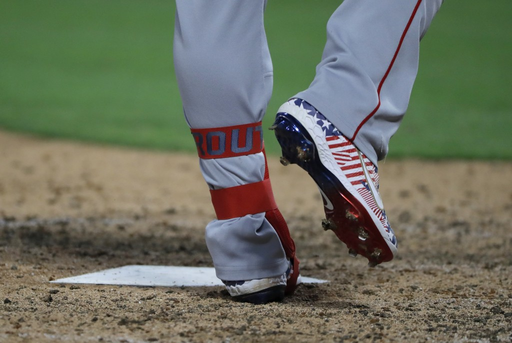 Los Angeles Angels' Mike Trout wears holiday-themed shoes while batting against the Texas Rangers in the seventh inning of a baseball game in Arlingto...