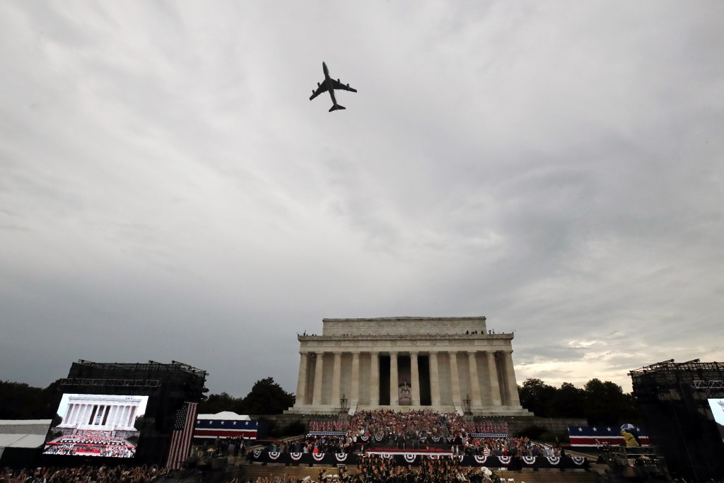 Special Air Mission 28000, Air Force One when the President is aboard, flies over Washington during an Independence Day celebration attended by Presid...