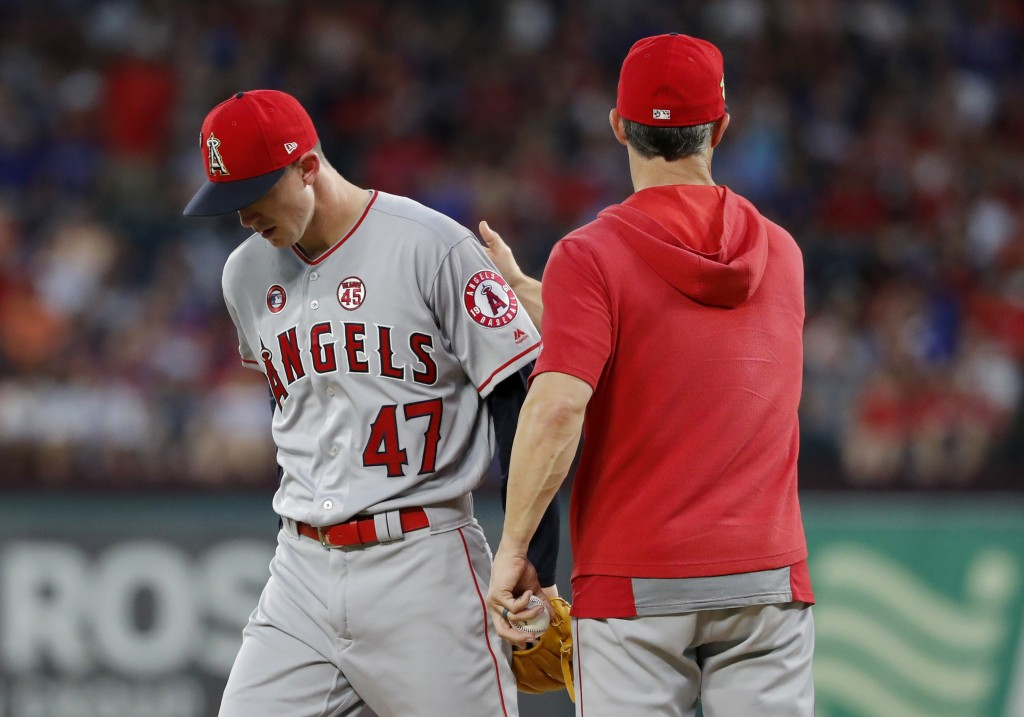 Los Angeles Angels' Griffin Canning (47) leaves the mound after turning the ball over to manager Brad Ausmus during the fourth inning of the team's ba...