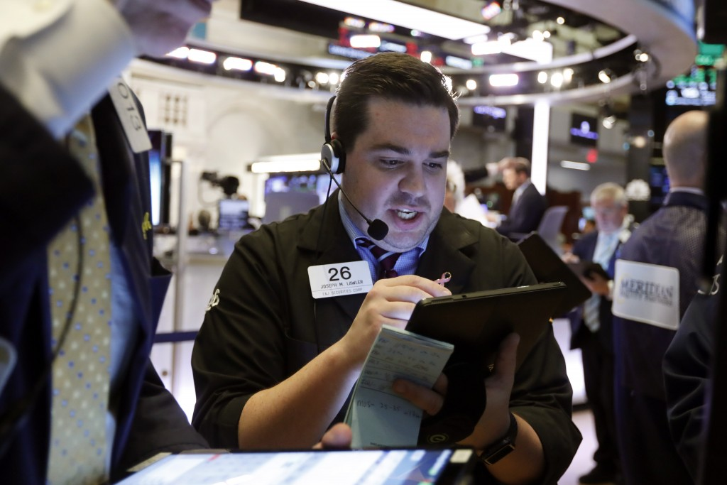 FILE - In this July 1, 2019, file photo trader Joseph Lawler works on the floor of the New York Stock Exchange. The U.S. stock market opens at 9:30 a.