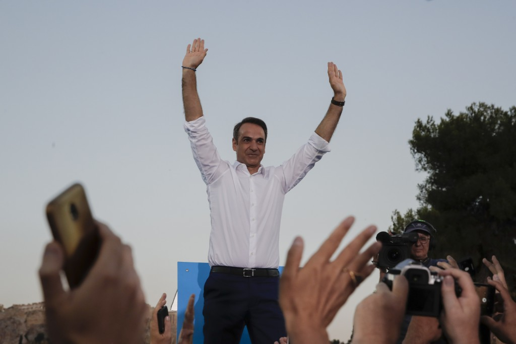 Greek opposition New Democracy party leader Kyriakos Mitsotakis waves to supporters during his main election campaign rally in Athens, on Thursday, Ju