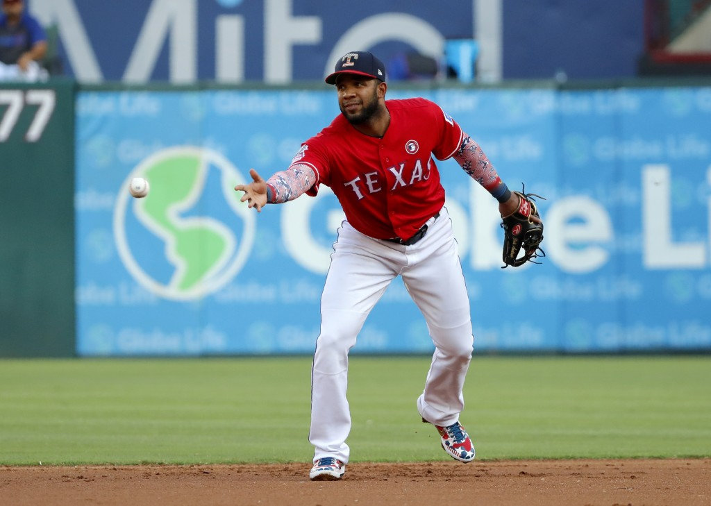 Texas Rangers shortstop Elvis Andrus tosses the ball to second for the force out on Los Angeles Angels' Shohei Ohtani during the first inning of a bas...