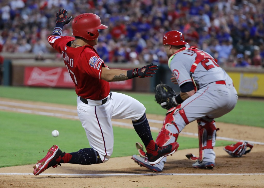 Texas Rangers' Shin-Soo Choo, left, slides ahead of the throw to Los Angeles Angels' Jonathan Lucro during the fourth inning of a baseball game in Arl...