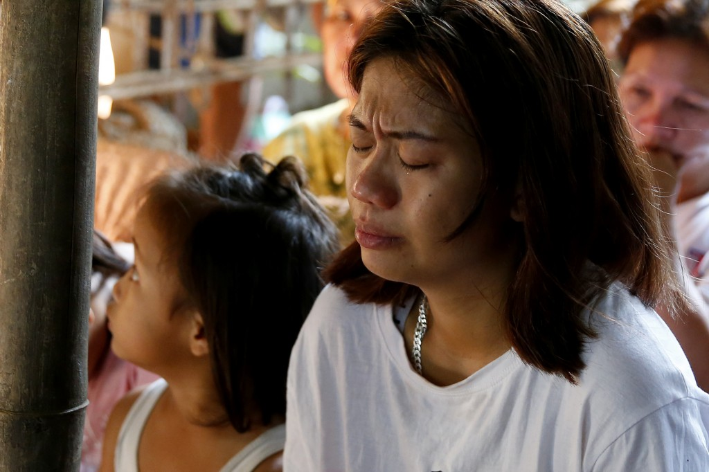 In this Friday, July 5, 2019, file photo, Leejay Acopio, the mother of the slain three-year-old girl Myka Upina, cries during mass at her wake at Rodr