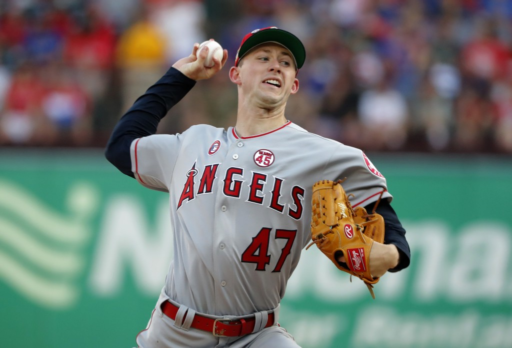 Los Angeles Angels starting pitcher Griffin Canning (47) throws to a Texas Rangers batter during the first inning of a baseball game in Arlington, Tex...