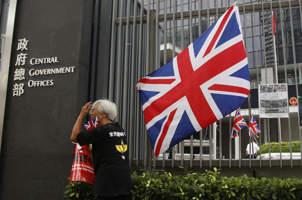 In this Thursday July 4, 2019, photo, Alexandra Wong, 63, a protester who's often seen raising the Union Jack at demonstrations and carried one into t
