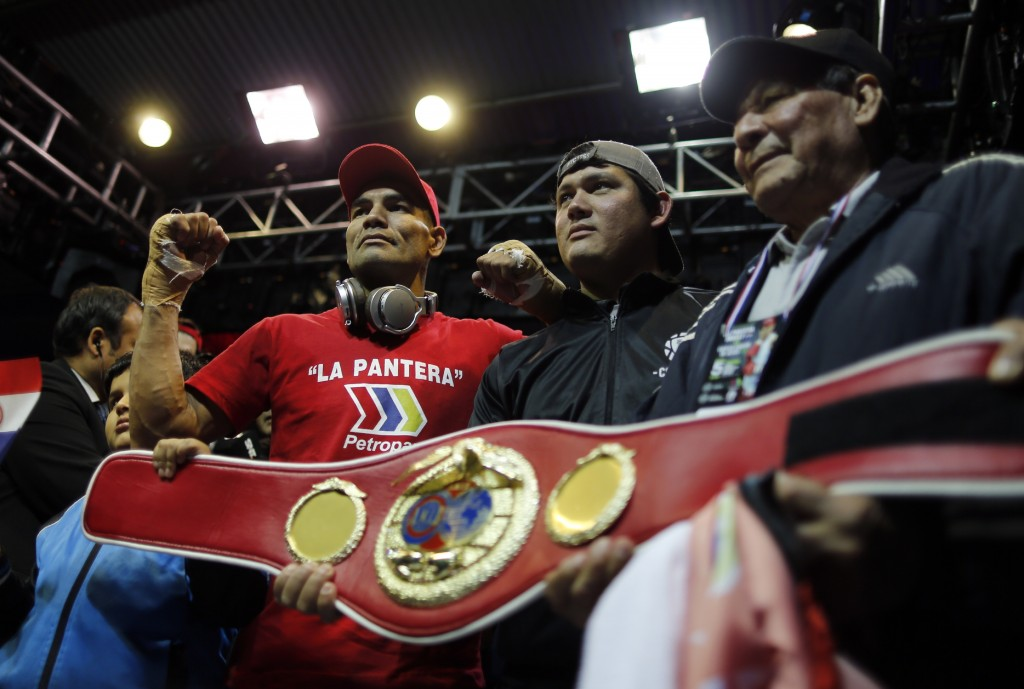 Paraguayan boxer Richard Moray, left, pose for a photo with relatives after the his super-welter weight South American title victory over Brazilian bo...
