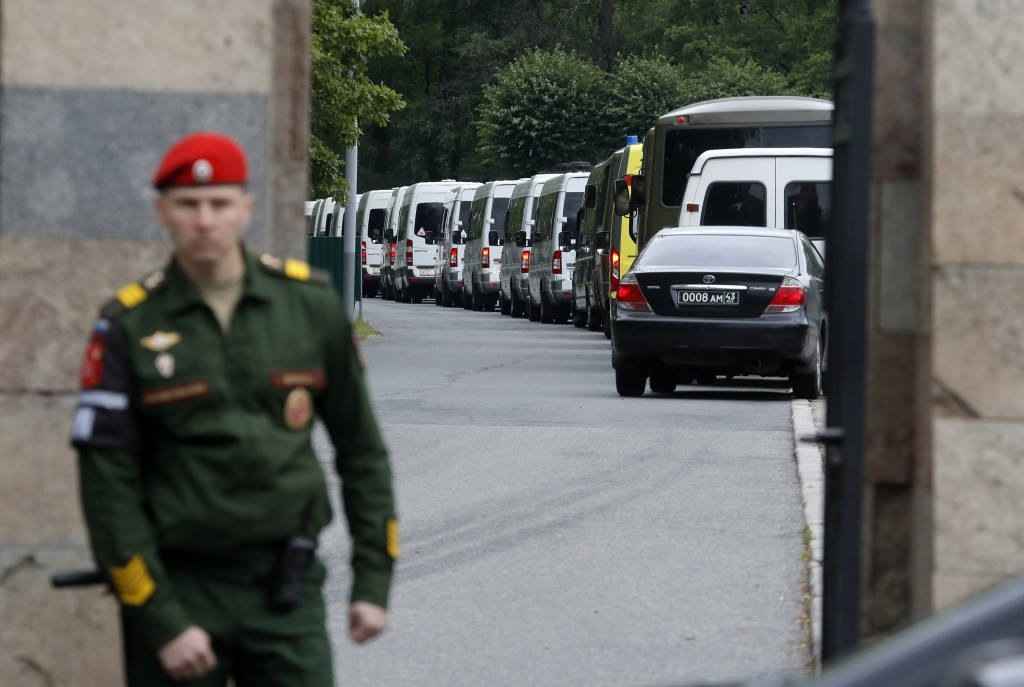 Buses carrying bodies of the 14 crew members who died in a fire on a Russian navy's deep-sea research submersible, drive to the Serafimovskoye memoria