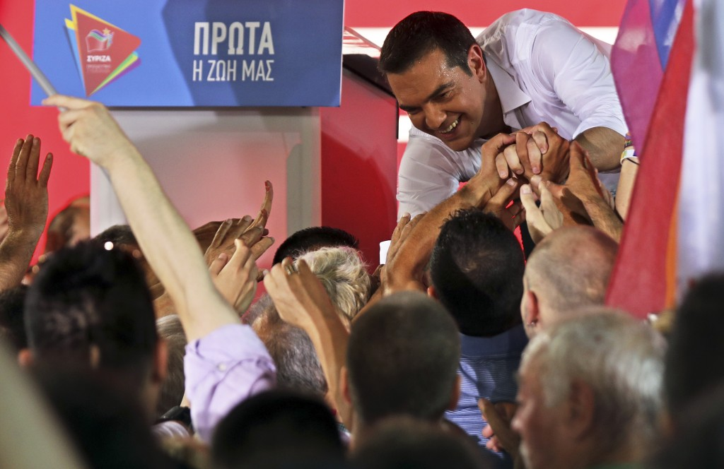 Greek Prime Minister and Syriza party leader Alexis Tsipras greets supporters during his main election campaign rally in Athens, Friday, July 5, 2019.
