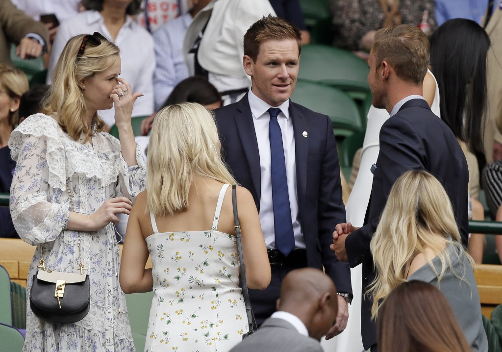 England one day cricket team captain Eoin Morgan arrives to take his seat in the Royal Box on Centre Court during day six of the Wimbledon Tennis Cham...