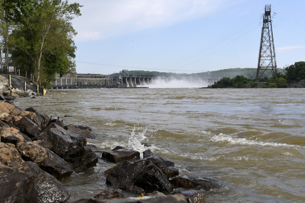 Water flows through Conowingo Dam, a hydroelectric dam spanning the lower Susquehanna River near Conowingo, Md., on Thursday, May 16, 2019. Officials ...