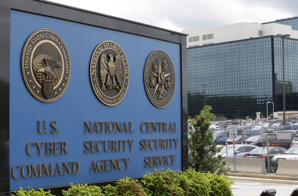 FILE - In this June 6, 2013 file photo, the sign outside the National Security Administration (NSA) campus in Fort Meade, Md. A high-profile raid at t...