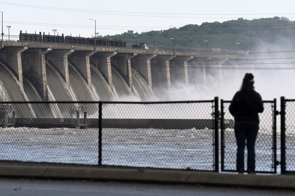 A woman stands near Conowingo Dam, a hydroelectric dam spanning the lower Susquehanna River near Conowingo, Md., on Thursday, May 16, 2019. Officials ...