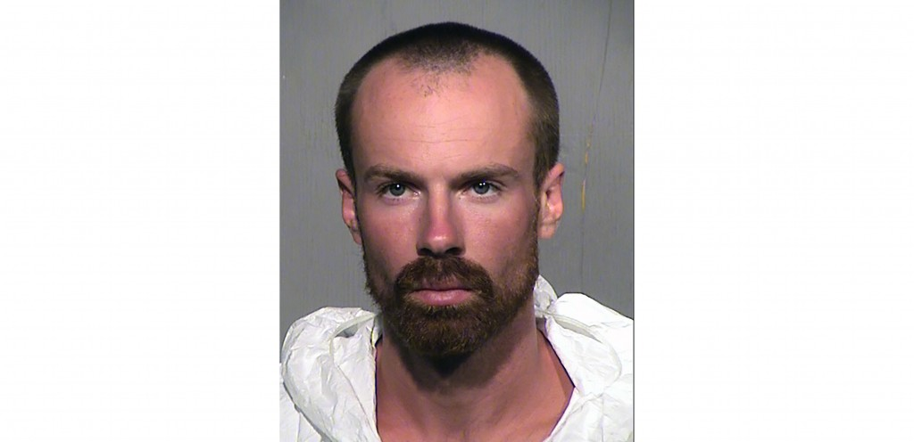 This undated booking photo provided by the Maricopa County Sheriff Office shows 27-year-old Michael Adams who has been arrested on suspicion of first-...