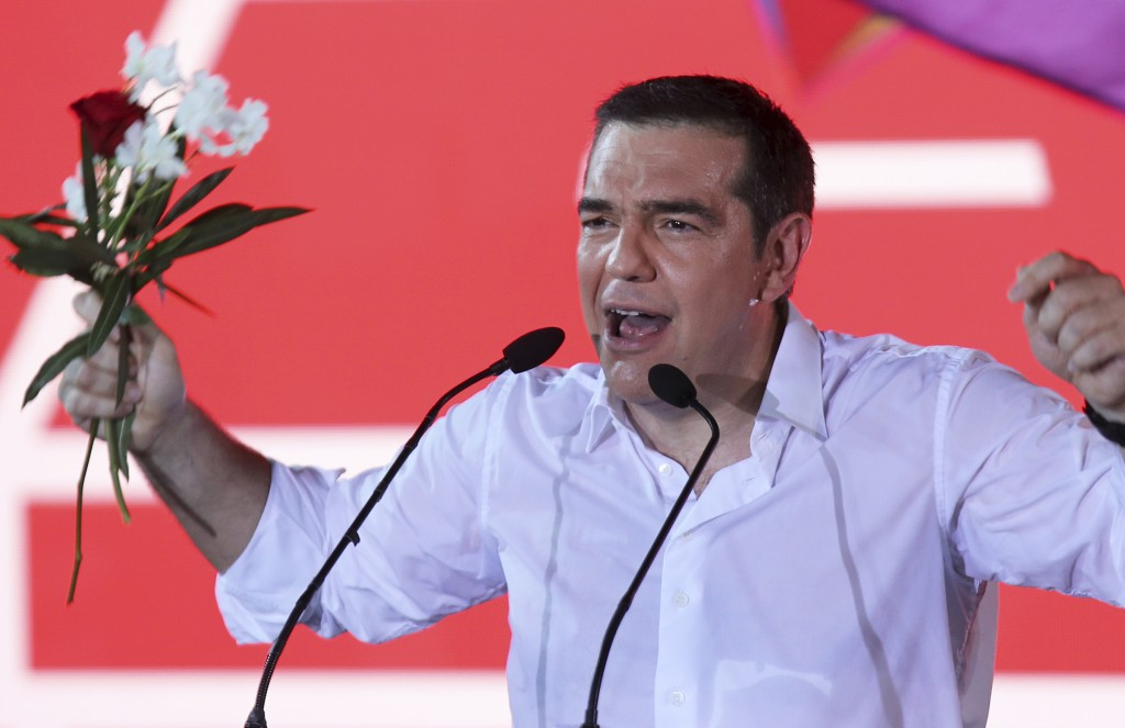 Greek Prime Minister and Syriza party leader Alexis Tsipras addresses supporters during his main election campaign rally in Athens, Friday, July 5, 20