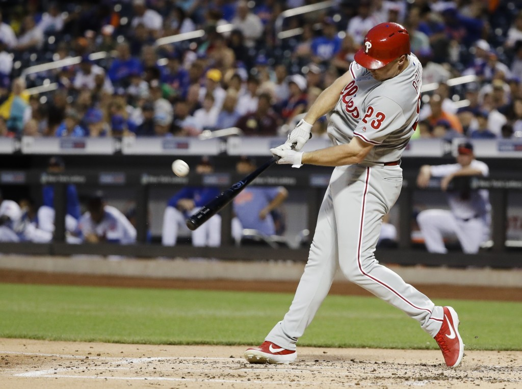 Philadelphia Phillies' Jay Bruce hits a two-run home run during the second inning of a baseball game against the New York Mets, Saturday, July 6, 2019...