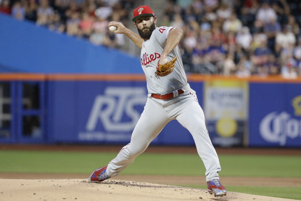 Philadelphia Phillies' Jake Arrieta delivers a pitch during the first inning of a baseball game against the New York Mets, Saturday, July 6, 2019, in ...