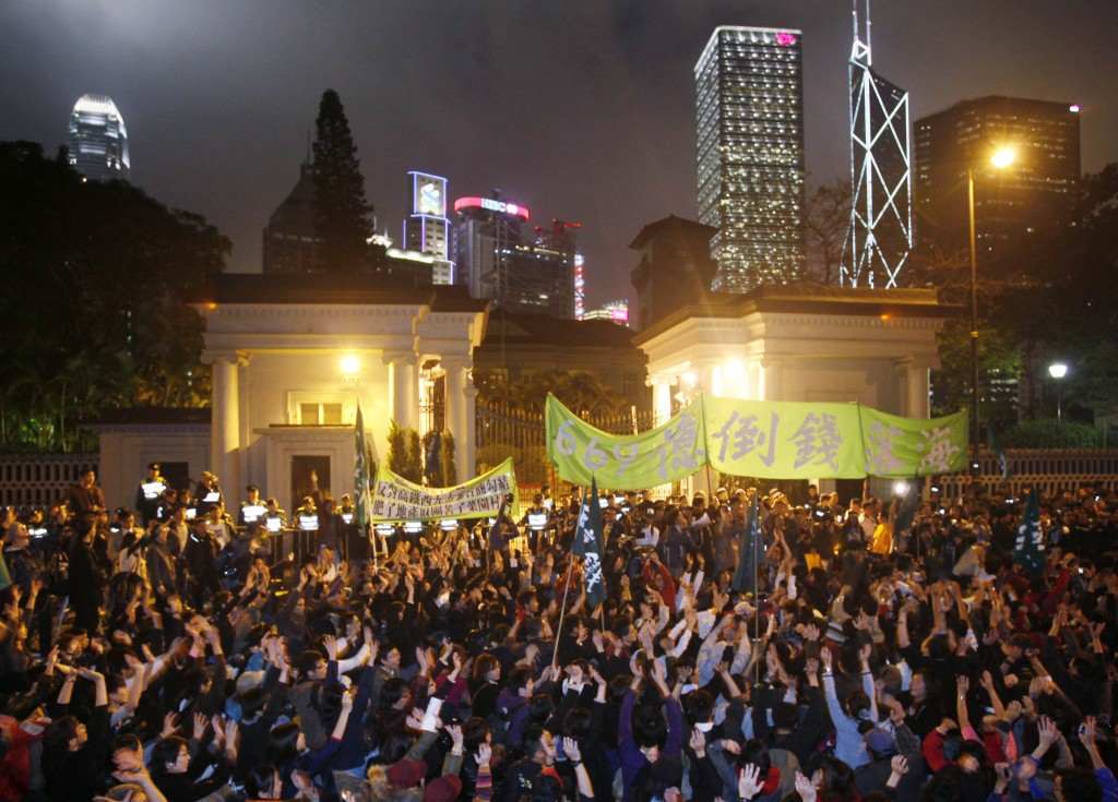 "FILE - In this Jan. 15, 2010, file photo, protesters against the ""High-Speed Rail"" link demonstrate outside the Hong Kong government house as the prot"