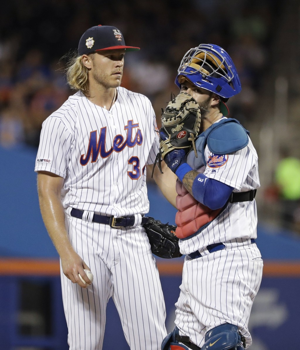 New York Mets starting pitcher Noah Syndergaard, left, talks with catcher Tomas Nido during the second inning of a baseball game against the New York