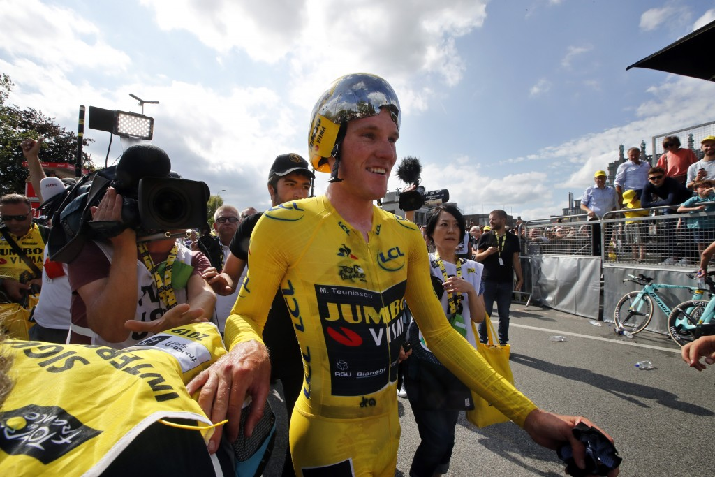 Netherlands' Mike Teunissen of the Team Jumbo Visma, wearing the overall leader's yellow jersey, celebrates following the second stage of the Tour de ...