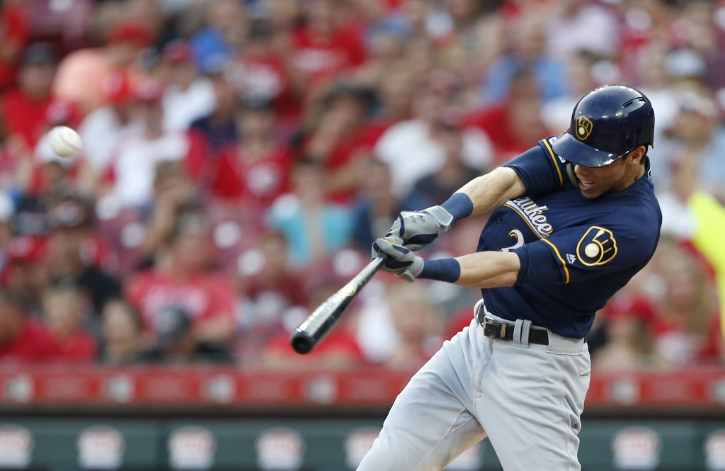 FILE - In this July 2, 2019, file photo, Milwaukee Brewers' Christian Yelich hits a solo home run off Cincinnati Reds starting pitcher Tanner Roark du