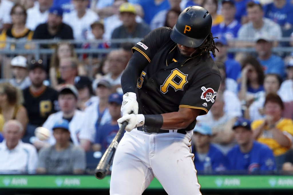 FILE - In this July 1, 2019, file photo, Pittsburgh Pirates' Josh Bell hits a three-run home run off Chicago Cubs starting pitcher Adbert Alzolay duri