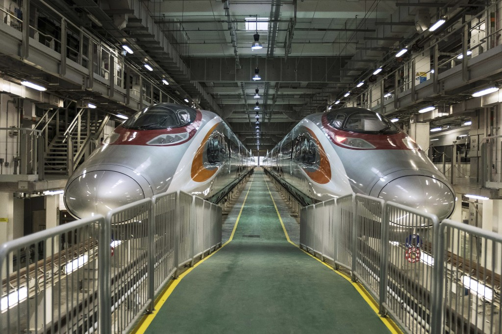 FILE - In this Aug. 2, 2017, file photo, two Guangzhou-Shenzhen-Hong Kong Express Rail Link (XRL) trains in Hong Kong. Protesters in Hong Kong have ch...