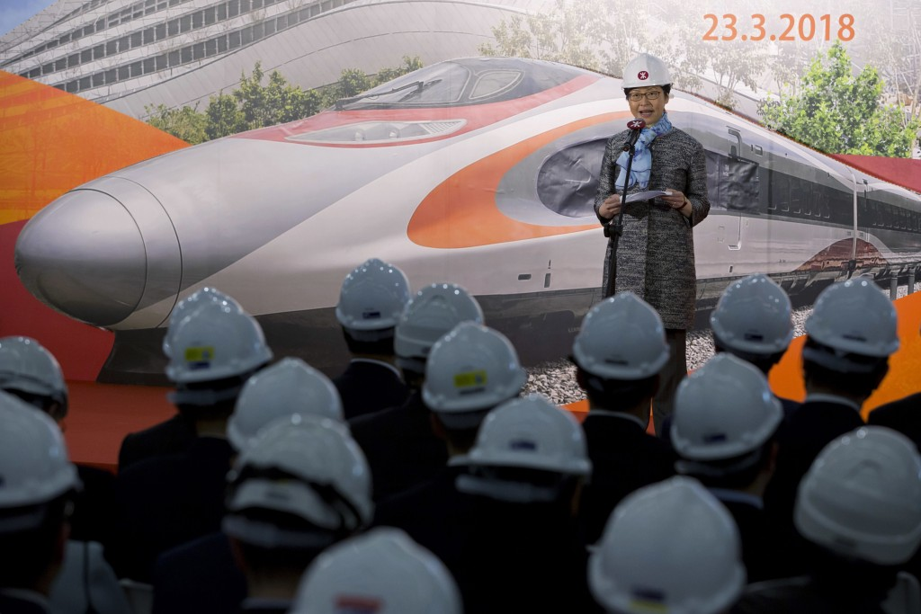 FILE - In this March 23, 2018, file photo, Hong Kong Chief Executive Carrie Lam speaks during the Main Works Completion Ceremony of the Express Rail L...