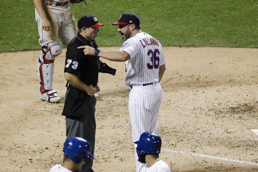 New York Mets manager Mickey Callaway, right, argues with home plate umpire Tripp Gibson after Callaway was ejected during the fifth inning the team's