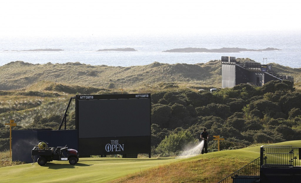 A member of the groundstaff waters the greens on the Dunluce Links course at Royal Portrush Golf Club, Northern Ireland, Saturday, July, 6th 2019. The