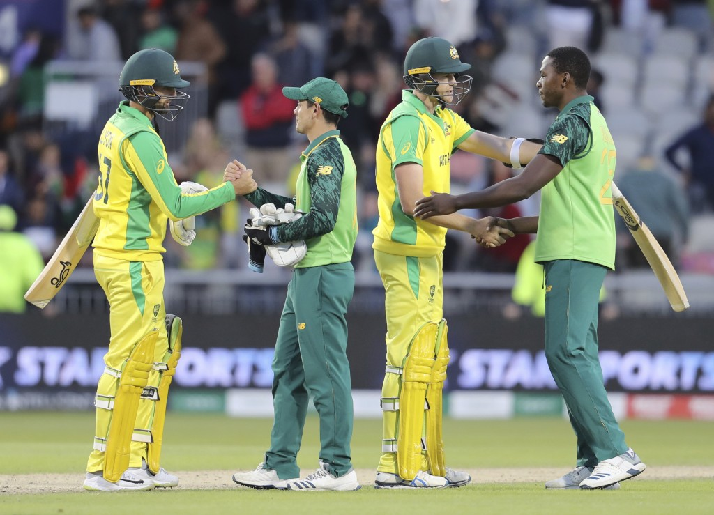 Australian and South African players shake hands at the end of the Cricket World Cup match between Australia and South Africa at Old Trafford in Manch...