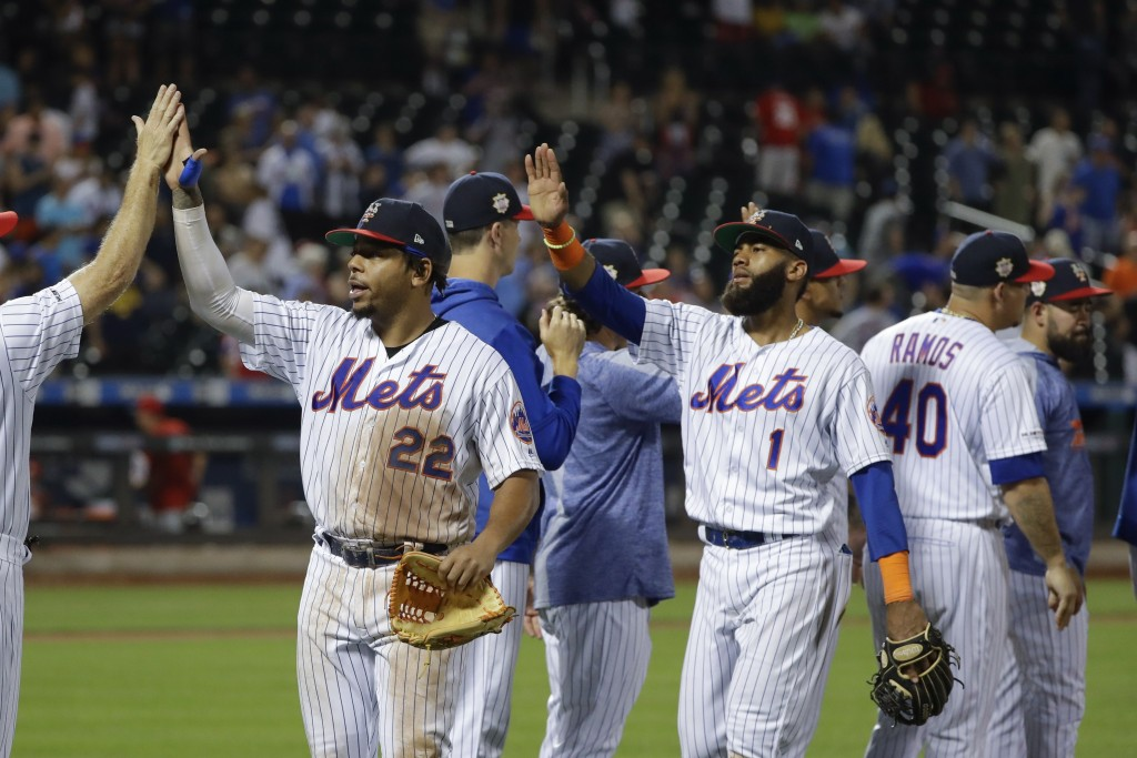 New York Mets' Dominic Smith (22) and Amed Rosario (1) celebrate with teammates after a baseball game against the Philadelphia Phillies on Saturday, J...