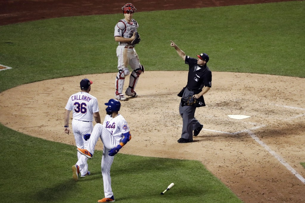 New York Mets manager Mickey Callaway (36) is ejected after arguing with home plate umpire Tripp Gibson, right, after Mets' Amed Rosario (1) was hit b...
