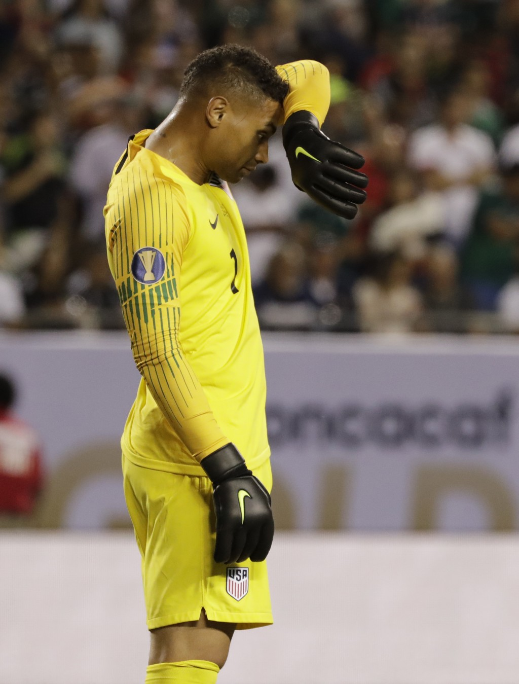 United States goalie Zack Steffen wipes his face during the second half of the CONCACAF Gold Cup final soccer match against Mexico in Chicago, Sunday,...