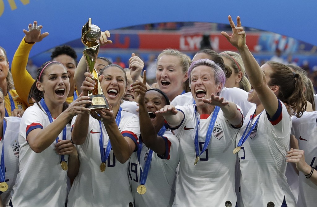 United States' team celebrates with trophy after winning the Women's World Cup final soccer match between US and The Netherlands at the Stade de Lyon