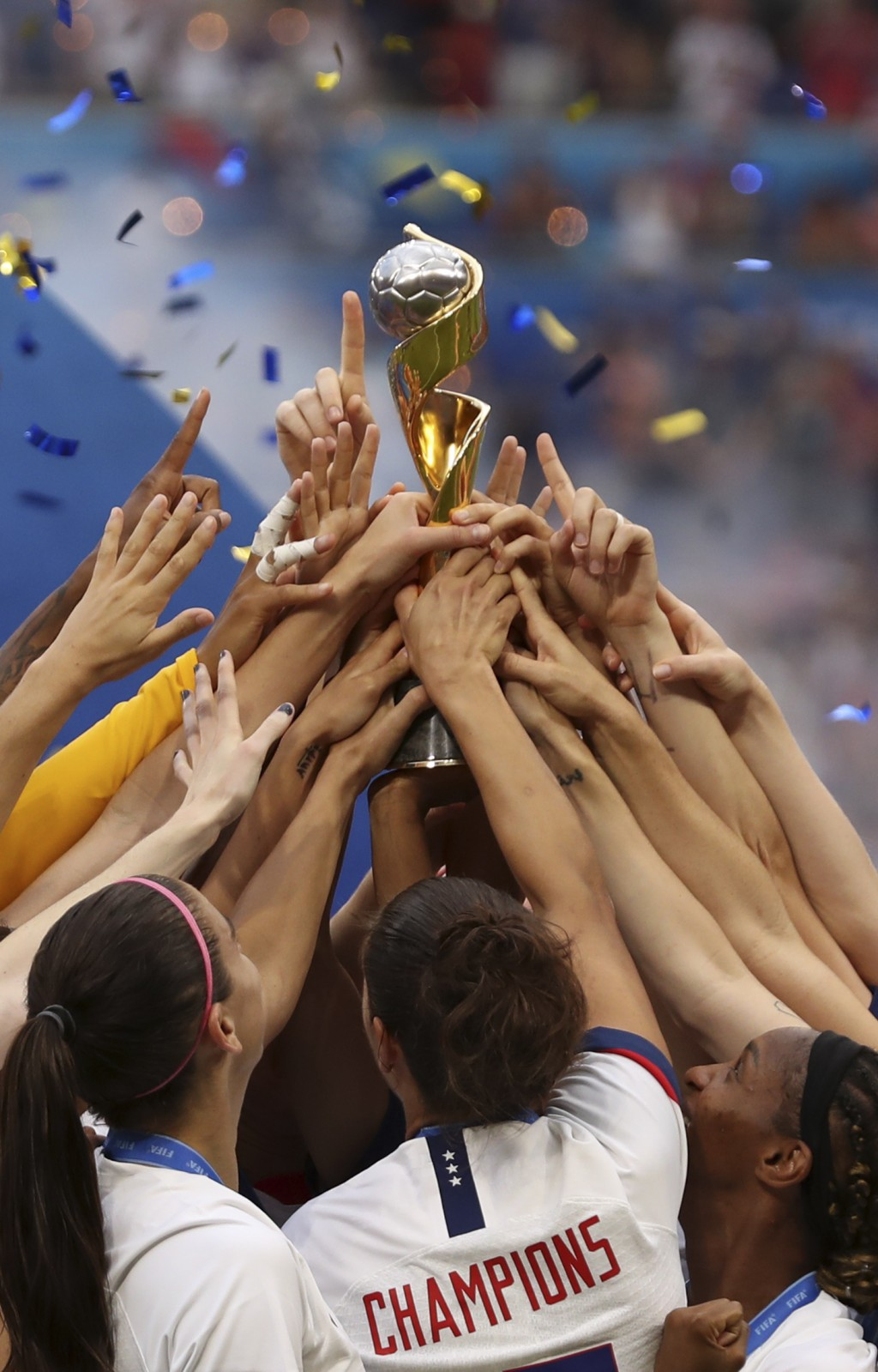 The United States players hold the trophy celebrating at the end of the Women's World Cup final soccer match between US and The Netherlands at the Sta...