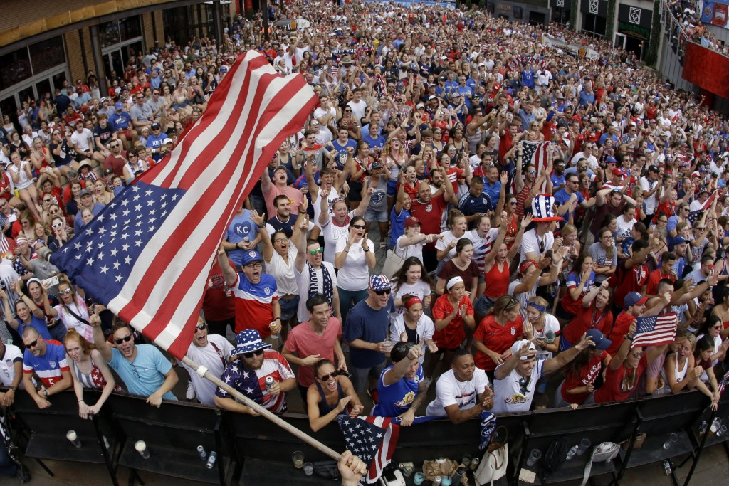 Fans celebrate after the United States scored a goal in the 2019 FIFA Women's World Cup soccer final between against the Netherlands Sunday, July 7, 2...