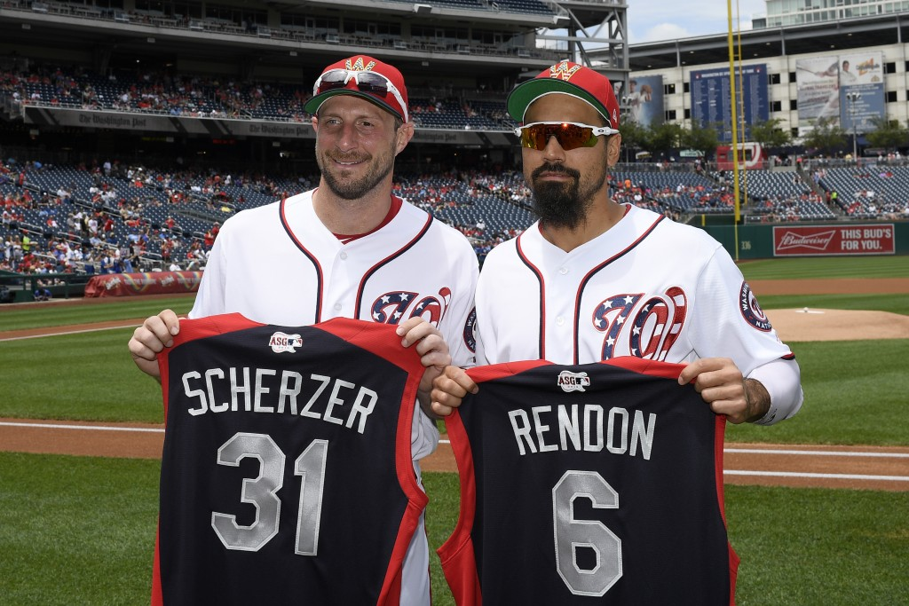 Washington Nationals' Max Scherzer, left, and Anthony Rendon, right, pose with All-Star jerseys before a baseball game against the Kansas City Royals,
