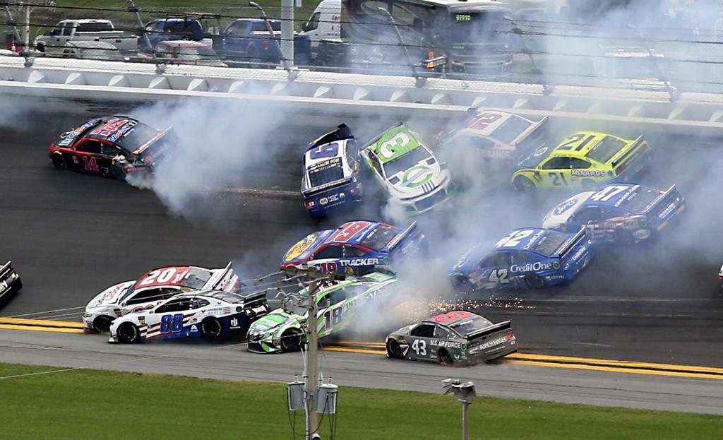 Cars crash, including Alex Bowman (88), Kyle Busch (18), Erik Jones (20), Darrell Wallace Jr. (43), Chase Elliott (9) and Austin Dillon (3) coming out...