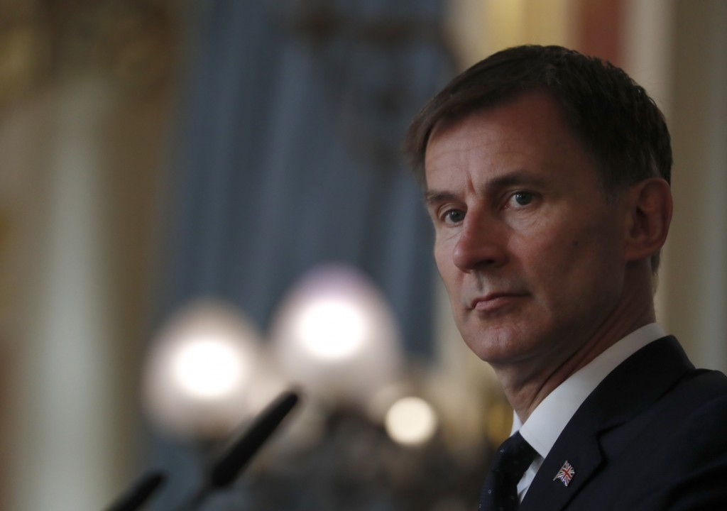 Britain's Foreign Secretary Jeremy Hunt, listens to a question during a press conference with the Bishop of Truro Philip Mounstephen about the Bishop'
