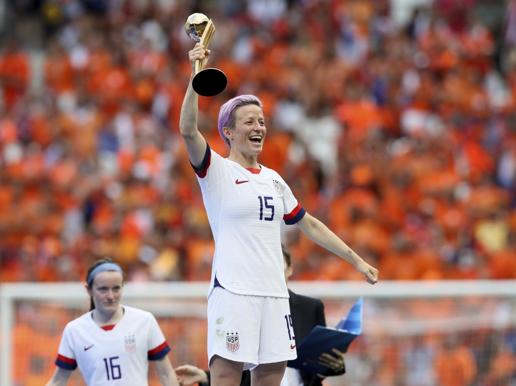 United States' Megan Rapinoe celebrates her team's victory with the trophy after the Women's World Cup final soccer match between US and The Netherlan...