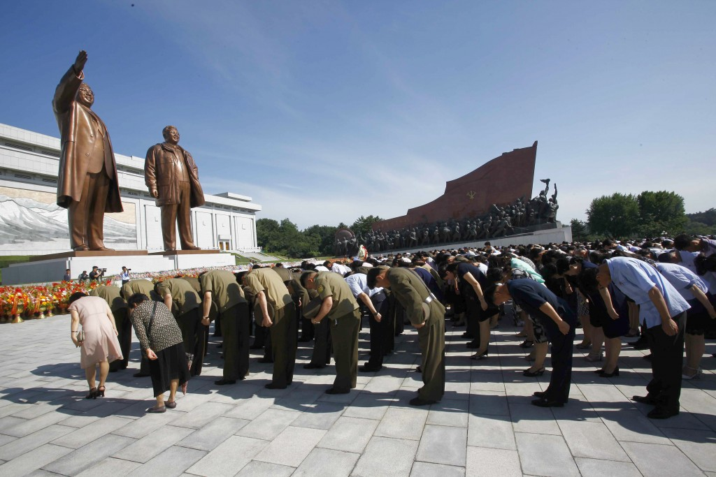 In this Monday, July 8, 2019, file photo, people visit Mansu Hill to pay tribute to the late leaders Kim Il Sung and Kim Jong Il on the occasion of th