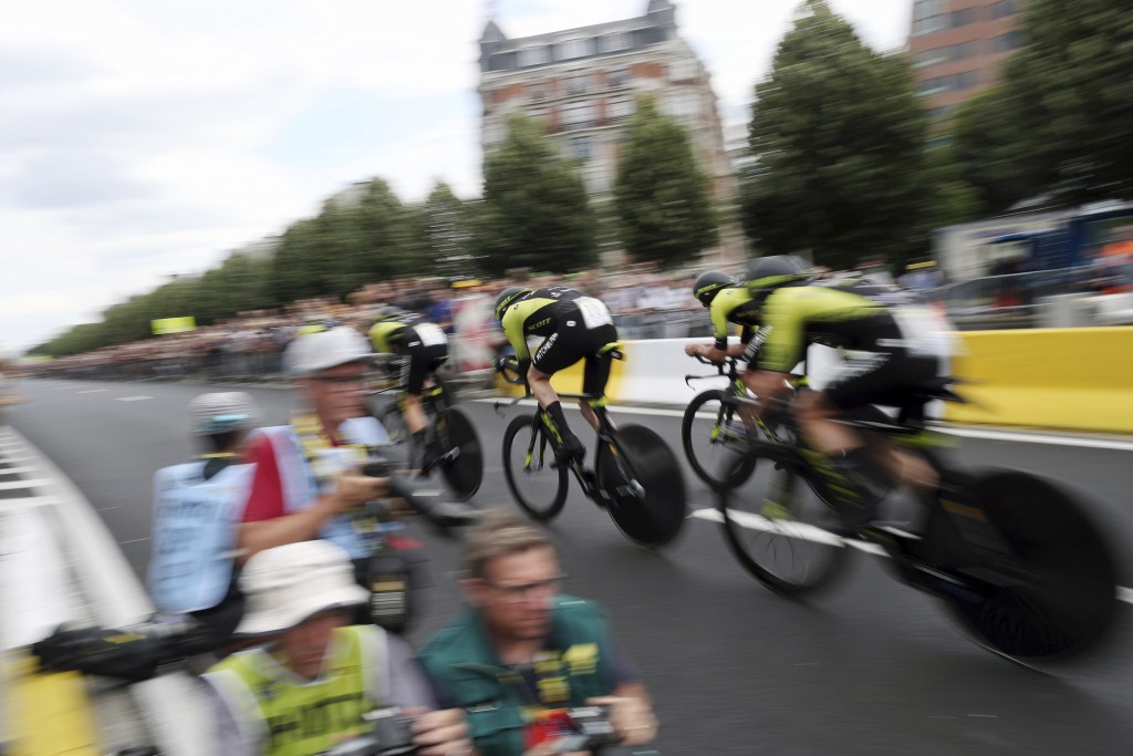 Mitchelton Scott team strains during the second stage of the Tour de France cycling race, a team time trial over 27.6 kilometers (17 miles) with start