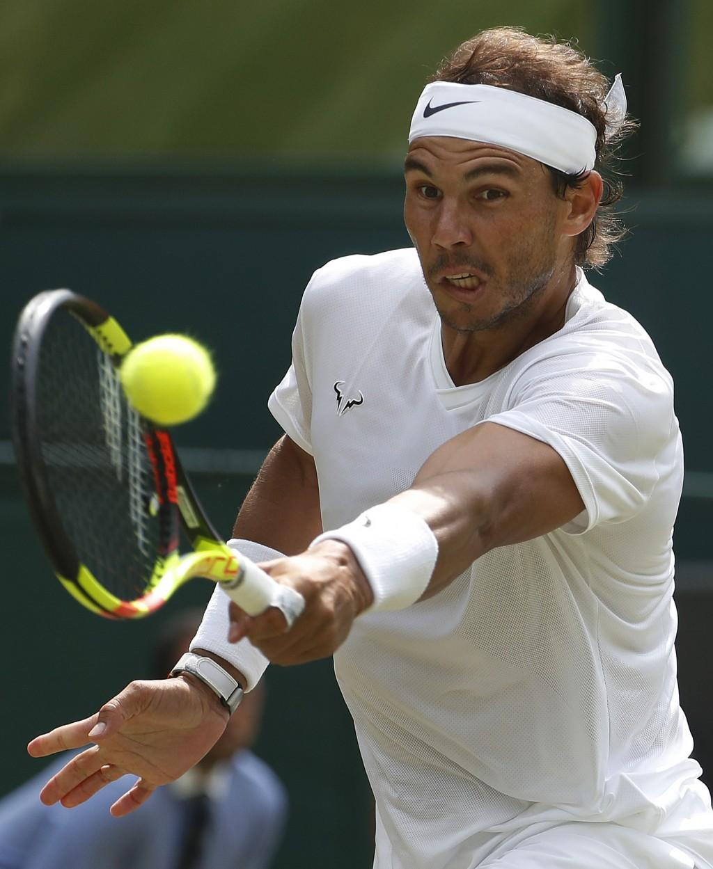 Spain's Rafael Nadal returns to Portugal's Joao So...