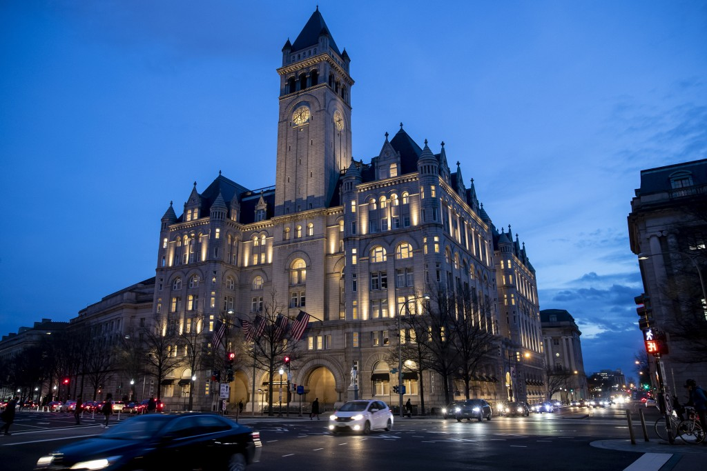 FILE - In this Jan. 23, 2019, file photo, the Trump International Hotel near sunset in Washington. The Justice Department is challenging a District of...