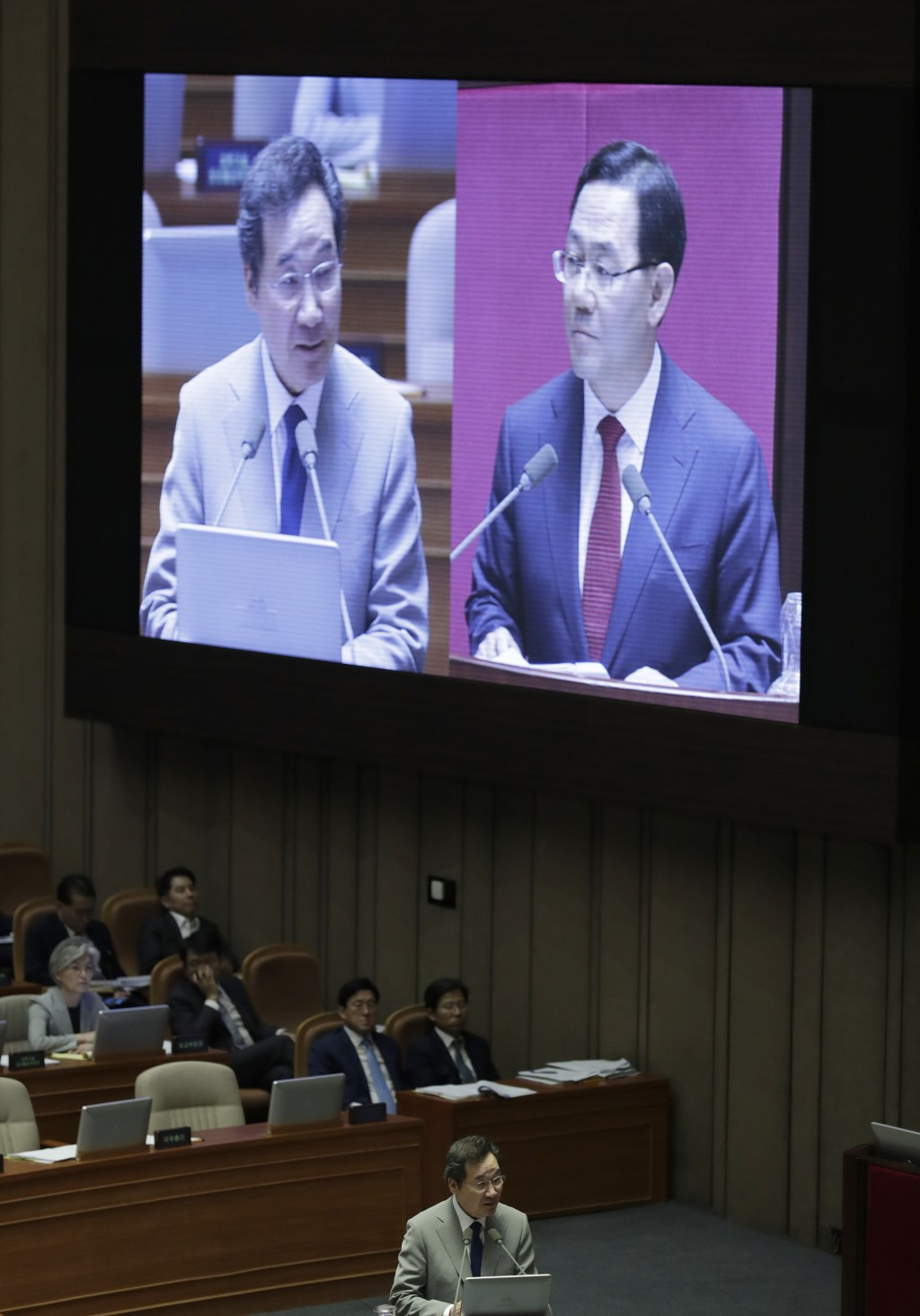 South Korean Prime Minister Lee Nak-yon, bottom, answers questions during a plenary session at National Assembly in Seoul, South Korea, Tuesday, July